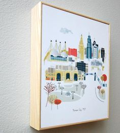 Hang up a scenic souvenir of your favorite city with this wood framed art print. Each whimsical illustration features a look at downtown, complete with key buildings, landmarks and natural formations. Before mounting within the ash wood frame, the artwork is coated with a layer of UV-protective laminate, to keep the illustration free of smudges and fingerprints.
