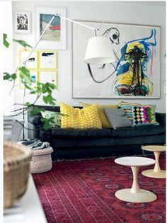 I like the combination of the carpet, bright pillows and artwork.