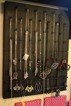 Bought a $10 frame from Home Goods and a small doweling rod and screws from a hardware store and created this!  Such a cute way to display and organize jewelry!