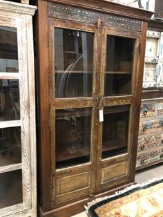 This is one-of-a-kind piece that features reclaimed wood which has been handcrafted & hand carved! This may be used for a armoire or any other type of storage/display piece!  Manzel, 96 Foster St., Peabody, MA and www.manzelinc.com. #boho #gypsychic #eclectic *oneofakind Rustic Wood Furniture, Online Furniture Stores, Armoire, Hand Carved, Carving, Display, Boho, Type, Storage