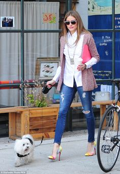 Olivia Palermo simple outfit was perfect for the season as she teamed stylishly ripped blue skinny jeans with a crisp whi...