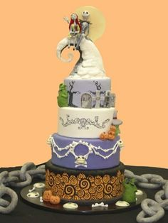 Halloween Wedding Cake....this is really cute and it seems that people either have a Nightmare before Xmas or Corpse bride themed cake but me and tim are having a haunted mansionish wedding.