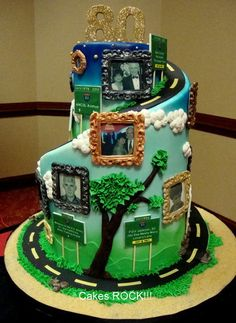 "I love how this cake tells a story. The picture frames along the ""Road of Life"" are a really nice touch."
