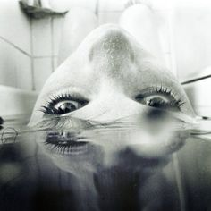 Beautiful, unique perception of woman/reflection in the tub