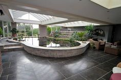 This clean and crisp large indoor pond brings some nice curves in to this very angular indoor space