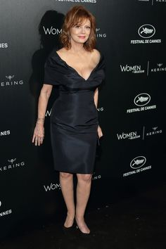 15 May Susan Sarandon wore a navy off-the-shoulder dress to the 'Women In Motion' event.   - HarpersBAZAAR.co.uk