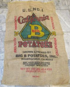 I try to get as many of these farm burlap sacks because they are so decorative and useful. You can hang this as part of your country living decor, you can frame it and fancy it up, you can use this to make a pillow, or a footstool, or a chair cover, and you're probably thinking of other uses too. The color and decoration are crisp, the burlap is in good condition, and there are a few superficial marks and stains here and there, some smudges and some pulls in the burlap from laying around in stor Country Living Decor, Burlap Sacks, Vintage California, Old Antiques, Dollhouse Miniatures, Crisp, Potatoes, Stains, Fancy