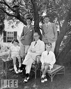 Joseph P. Kennedy and the sons he groomed to become America's Political Dynasty, poses at the family home in Hyannis, Mass. in 1935 with his sons (clockwise from left) Edward, John, Joseph Jr., and Robert. Three of the boys would rise to the top; three would die tragically.