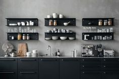 Vipp black kitchen in an advertsing agency studio in Manhattan used for creative pauses and coffee refills