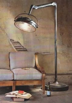 Oversized standing Industrial-style lamp - it has a sense of being robotic, as if it would follow you or respond to verbal commands (a la machines in Iron Man's lab)