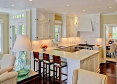 Small kitchen, but gorgeous.    Great extra cabinet space below the sidebar, simple but architecturally interesting stove hood, and classic white subway tile for the backsplash.  Brooke Shields Hamptons house 413 (9)