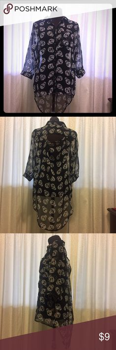 Shear Black Shirt with Skulls Gently used. 3/4 length sleeves, regular Renata in front, long in back with peekaboo window in back between shoulders. Slight imperfection in front. See last photo Tramp Tops Button Down Shirts
