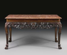 An Irish George II mahogany side table circa 1750,  Marble top later, frieze reduced in height. height 30 in.; width 4 ft. 5 in.; depth 27 1/4 in. 76.2 cm; 134.6 cm; 69.2 cm