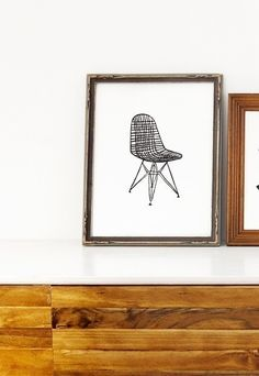 This print is a hand carved, printed and pulled, open edition linocut of a Charles and Ray Eames designed wire chair.