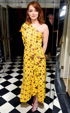 Emma Stone in a yellow printed one-sleeve Gucci dress