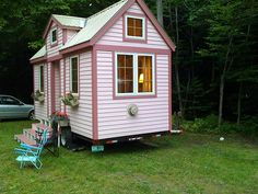 A little too pink for me, but a different layout from a lot of the Tiny Houses. Notice the side door. No real porch, so that's a deal killer for me.