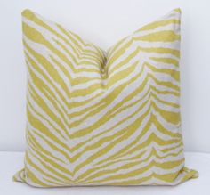 Pillow cover designed to fit an insert 16x16, 18x18 or 20x20.  Same fabric on both sides.  Invisible zipper for easy removal and a tailored look.