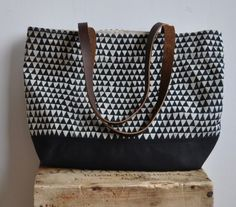 100% hemp canvas with hand mixed textile ink, organic cotton black base, upcycled leather handles. mmmmm.