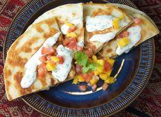 Sweet potato quesadilla with mango salsa and lime & cilantro crema, from the Bored Vegetarian.