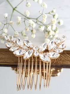 Bridal Hair Comb,Swarovski Hair Comb,Rhinestone Hair Comb,Bridal Hair Accessories,Rose Gold Hair Comb,Bridal Silver Hair Comb,Bridal Jewelry  This handmade Swarovski Hair Comb 24 k plated over brass are designed to make an impact set with clear white marquise Crystals. available in 3 different platings Petite Delights is an Official SWAROVSKI® Branding Partner Official Swarovski Elements® Partner Made with real genuine high quality Austrian Swarovski ©Crystal .  ♥ Genuine Swarovski tags ♥ 1…