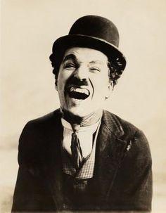 C.C. Charlie Chaplin, silent movie, powerful face, expression, intense eyes, portrait, photo b/w