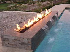 creative outdoor gas fire pit in rectangular shape designed as pool fountains: gas fire pit arrangement ideas in creating practically firepl...