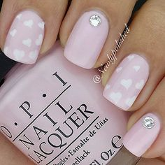 11. 3D Flower Accent Nail This elegant and girly nail design is fit for everyday wear. Besides being absolutely beautiful, this nail design is also quite easy to create. You just need to place some pearl studs and a 3D nail flower to your fingernail and you're good to go! 12. Nude & Dark Blue Coffin …