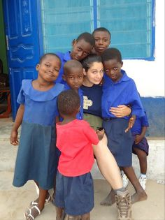 A volunteer playing with children in an orphanage, in Ghana