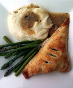 Tofu Pot Pie recipe in puff pastry dough. Served it alongside steamed asparagus, mashed potatoes and mushroom gravy.