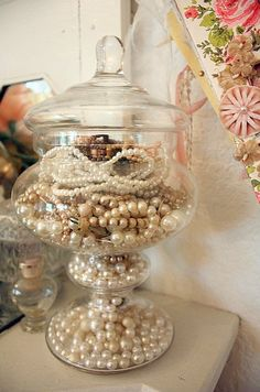 Great way to display pearl necklaces. Still have to figure out what to do with the pearl earrings . . .