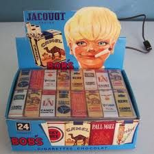 candy cigarettes with puff of smoke- Can't believe they used to sell this to kids! I used to buy them, lol!