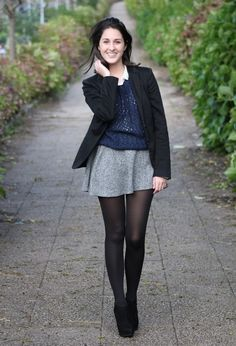 blue top and gray skirt with black tights and booties