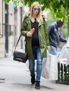 Nicky Hilton in a Madewell parka, dark denim skinnies, a black tee, and black high-top sneakers.