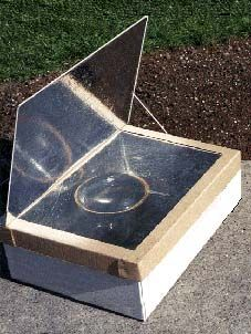 An easy-to-build solar oven made from cardboard boxes, foil, and a plastic cooking bag.