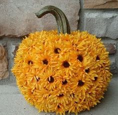 Cover your Halloween pumpkin with sunflowers if you want to avoid carving. From @cspeake #partyideas
