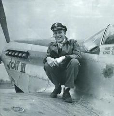 "Robin Olds and his P-51 named ""Scat VII."""