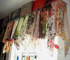 Vintage scarves sewn together for curtains. Wowza.