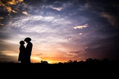 """There's this really silly rule about having """"no wide angles"""" in portraiture.  To that I say, screw the rules.  This image was taken with a wide angle, extremely small aperture and was purposely underexposed to get the beautiful sunset, and to get as much of it as possible.  :-)"""
