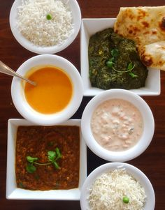 Top right: saag paneer. Middle left: tomato coconut soup. Middle right: raita. Bottom left: baingan bharta.