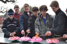 Jack W. '14, Steven F. '16, Doug W. '15, Isaac S. '17, Andrew S. '17, and Paul P. '16 light incense using the Lotus Flower candles in a Buddhist temple.