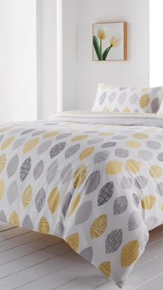 This Azuki Cotton Mix Duvet Set boasts a modern reversible patterned design with tones of greys and yellows set on a crisp white background. This set is perfect for adding a splash of colour to a neutral bedroom.