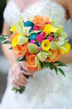 Sparks an idea: have a colorful bouquet, with each bridesmaid representing a different color dress pulled from the flowers
