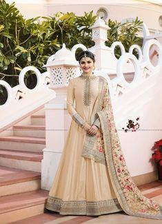 Presenting prachi beige art silk zari stone & thread worked designer suit. It contains art silk kameez comes with santoon bottom and matching net dupatta. Enhanced with zari ,thread & stone. Anarkali Gown, Saree Dress, Anarkali Suits, Lehenga Choli, Ethnic Gown, Indian Ethnic Wear, Designer Anarkali, Designer Gowns, Designer Wear