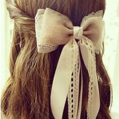 I also like the idea of a big bow with a veil attached for my hair because I love bows