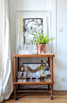 Whether you entertain guests for small dinners, cocktail parties or have overnight guests coming in the future, there's something decorative you can do that will instantly add sophistication and entertaining function to one of your rooms, as well as be a spot guests know they can return to on their own if they need a refill.