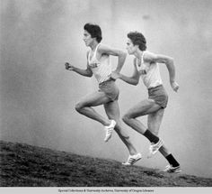 Black and white photo of University of Oregon cross-country runners Rudy Chapa (in front) and Alberto Salazar running up a hill during a 1978 race. ©University of Oregon Libraries - Special Collections and University Archives