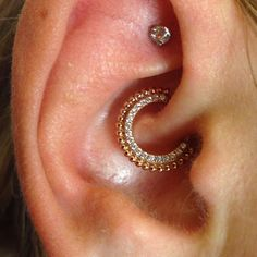 """This is the most stunning clicker and daith piercing. Piercing by APP member Tiffany Diamond. DV8 Body Art in Commerce, MI."""