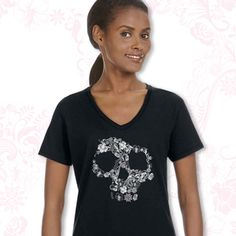 LADIES FLORAL SKULL V NECK One-color Floral Skull image screen printed on front, small one-color PDI Clothing logo screen printed on top back. This 4.2 oz. 100% combed and ringspun cotton v-neck t-shirt is extremely soft with side seams and a body flattering fit. Available at www.pdiclothing.com  Sizes: S – 2XL. Available Colors: Maroon, White, Black, Pink Price: $19.99
