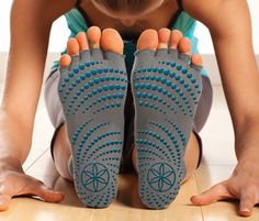 Gaiam Toeless Yoga Socks - The soles feature a no-slip grip that turns any surface into a mat.