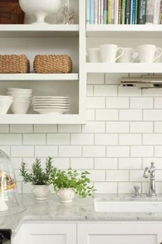 white subway tile backsplash ideas in a kitchen with marble countertops and white cabinets - Subway Tile Backsplash Ideas For The Kitchen